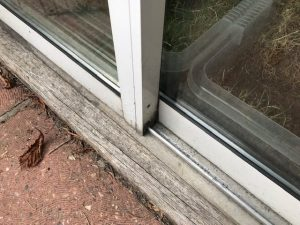 how to fix sliding glass door track problems