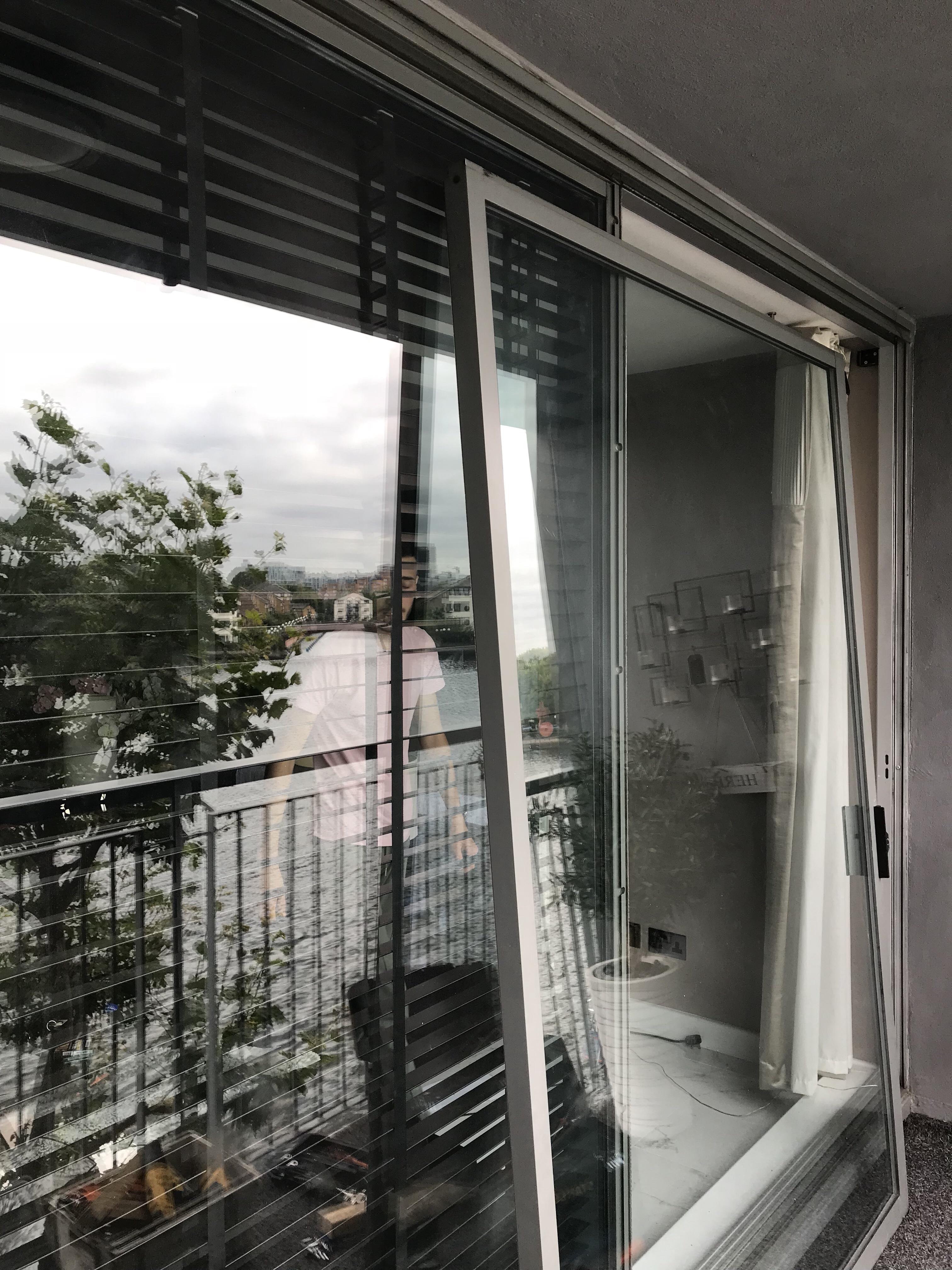 Sliding aluminium balcony door repair
